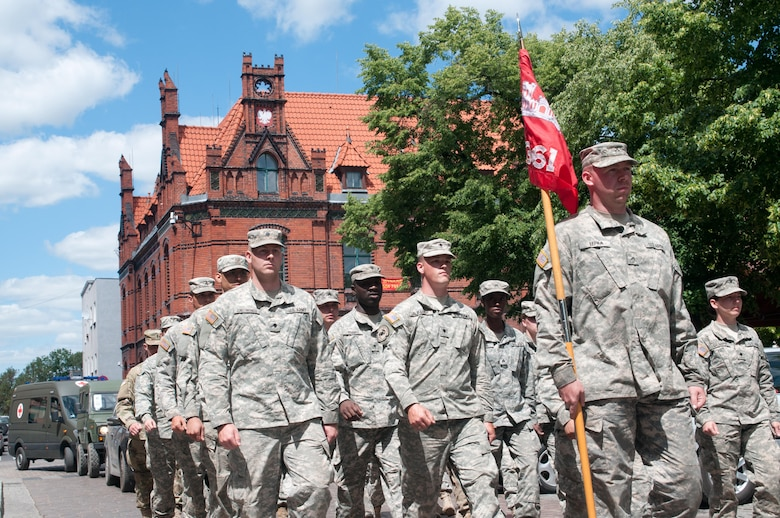 Soldiers of the 361st Engineer Company from Warner Robins, Ga., march along with soldiers from Poland, Macedonia, the U.K., Bulgaria, Germany and the Netherlands through the streets of Chelmno, Poland, as part of the opening ceremony of Exercise Anakonda 2016, a multi-national training event geared to enhance alliance interoperability and readiness.