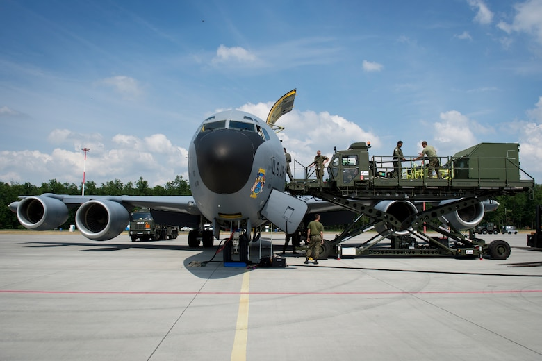 U.S. Air Force and Polish air force service members unload a KC-135 from the 100th Air Refueling Wing, England, in preparation for exercise Baltic Operations 2016 at Powidz Air Base, Poland, June 2, 2016. BALTOPS 2016, scheduled for June 3-19, 2016 in Estonia, Finland, Germany, Sweden, Poland, and throughout the Baltic Sea, is a joint, multinational, maritime-focused exercise designed to enhance flexibility and interoperability, as well as demonstrate resolve among NATO and partner forces to defend the Baltic region. The exercise will involve maritime, ground, and air forces to strengthen combined response capabilities necessary to ensure regional stability. (U.S. Air Force photo by Senior Airman Erin Babis/Released)
