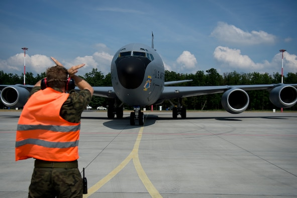 A Polish air force service member marshals a KC-135 from the 100th Air Refueling Wing, England, in preparation for exercise Baltic Operations 2016 at Powidz Air Base, Poland, June 2, 2016. Fifteen NATO and two partner nations will participate in the 44th iteration of the multinational maritime exercise BALTOPS 2016 in Estonia, Finland, Germany, Poland, Sweden, and throughout the Baltic Sea, June 3-19, 2016. (U.S. Air Force photo by Senior Airman Erin Babis/Released)