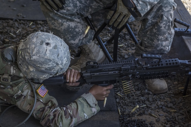 A Soldier in his 6th week of Basic Combat Training with Co. A, 3rd Bn., 39th Inf. Reg., fires the M249 Light Machine Gun at targets downrange on the U.S. Weapons Demonstration range at Fort Jackson, S.C., June 8. (U.S. Army photo by Sgt. 1st Class Brian Hamilton/ released)