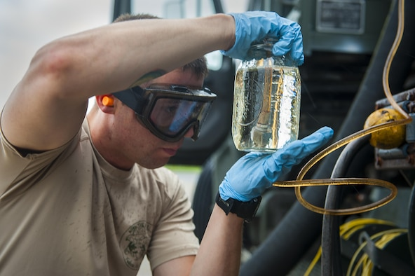Staff Sgt. Nicholas Samuelson, an 18th Logistics Readiness Squadron fuels distribution supervisor, samples fuel from a pump house April 13, 2016, at Kadena Air Base, Japan. The fuel is pumped out of the ground by an R-12 refueling truck and tested for impurities before going into an aircraft. (U.S. Air Force photo/Airman 1st Class Corey M. Pettis)