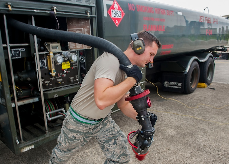 Airman 1st Class Terry Gilman, an 18th Logistics Readiness Squadron fuels distribution operator, pulls out a hose to refuel an aircraft April 13, 2016, at Kadena Air Base, Japan. Petroleum, oil and lubricant Airmen fuel the fight and are vital in keeping aircraft ready to go. (U.S. Air Force photo/Airman 1st Class Corey M. Pettis)