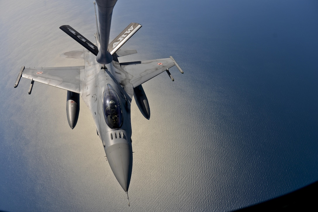 A Polish air force F-16 is refueled by a KC-135 Stratotanker from the 434th Air Refueling Wing, Grissom Air Reserve Base, Indiana, during Baltic Operations 2016 at Powidz Air Base, Poland, June 6, 2016. Deployed forces will work in tandem with naval forces to enhance flexibility and interoperability with participating NATO allies and partner nations by conducting a series of realistic, combined flying training including air defense, maritime awareness and support to amphibious operations. (U.S. Air Force photo/Senior Airman Erin Babis)