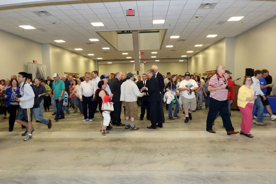 DAYTON, Ohio -- The fourth building ribbon cutting ceremony was held on June 8, 2016 at the National Museum of the U.S. Air Force. Here crowds enter into the new building to see four new galleries which feature 10 presidential aircraft, a world-class collection of flight test aircraft, along with the Space Shuttle Exhibit and huge cargo aircraft. (U.S. Air Force photo by Don Popp)