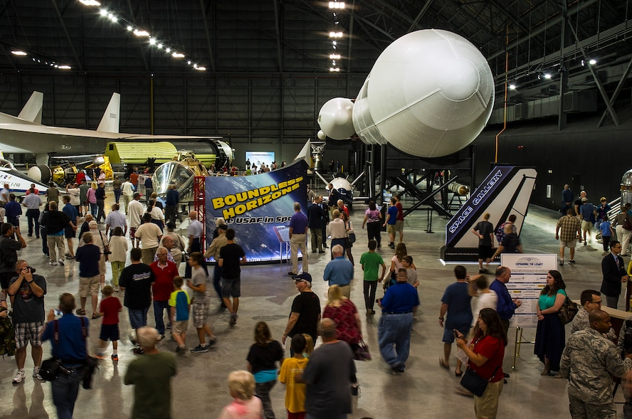 DAYTON, Ohio -- The fourth building ribbon cutting ceremony was held on June 8, 2016 at the National Museum of the U.S. Air Force. Here crowds enter into the new building to see four new galleries which feature 10 presidential aircraft, a world-class collection of flight test aircraft, along with the Space Shuttle Exhibit and huge cargo aircraft. (U.S. Air Force photo by Ken LaRock)