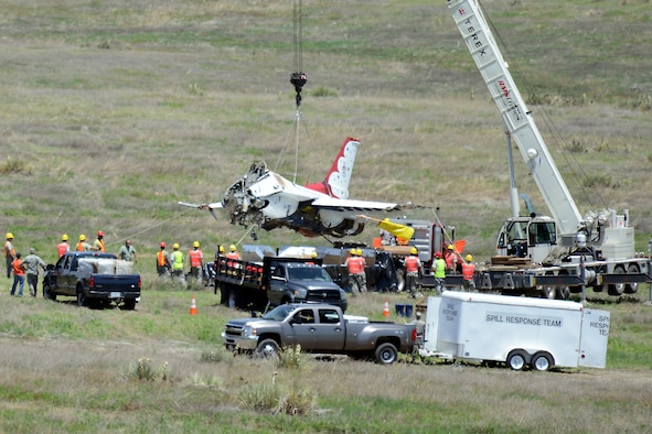 SECURITY-WIDEFIELD, Colo. – Joint service crews from several area military bases load Thunderbird 6 on a trailer for transport to Peterson Air Force Base, Colo., June 7, 2016. The aircraft crashed here June 2, 2016. (U.S. Air Force photo by Dave Meade)