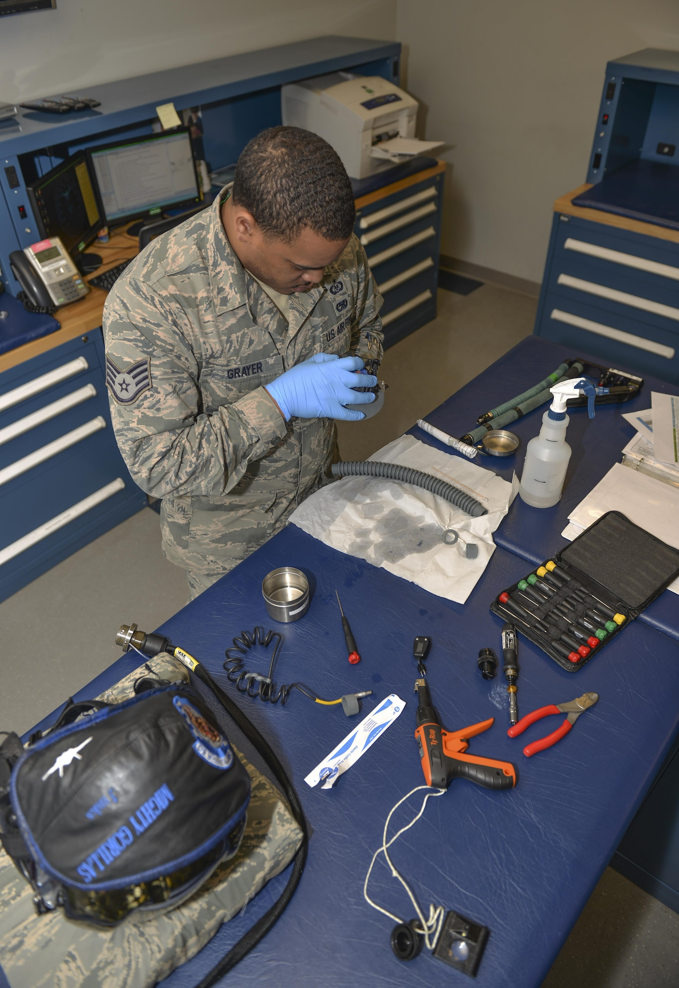 Staff Sgt. Kevin Grayer, 33rd Operations Support Squadron aircrew flight equipment technician, inspects an F-35A Lightning II helmet-mounted display at Eglin Air Force Base, Fla., Feb. 29, 2016. The F-35 display projects information onto the pilot's visor to provide maximum situational awareness while in flight. In legacy aircraft, this information is presented on a screen in the cockpit. Flight equipment technicians at the 33rd Fighter Wing are the leading AFE shop for the F-35 program making them responsible for creating action reports, joint technical data and updating fifth generation flight equipment. (U.S. Air Force photo/Senior Airman Andrea Posey)