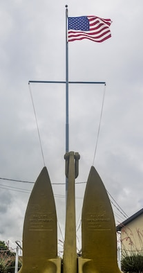 The original brass ship plates of the technical research ship USS Liberty ARTG-5 stand underneath the flag at the Liberty Memorial Park on Goodfellow Air Force Base, Texas, June 3, 2016. The park was dedicated in 2003 then expanded and renovated in 2004. (U.S. Air Force photo by 2nd Lt Tisha Wilkerson/Released)