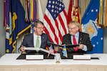 Defense Secretary Ash Carter signs a letter of intent with Swedish Defense Minister Peter Hultqvist at the Pentagon, June 8, 2016. DoD photo by Air Force Staff Sgt. Brigitte N. Brantley