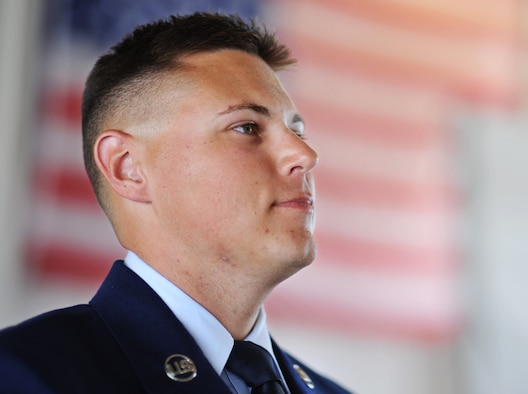 Airman 1st Class Ian Tracy stands at attention during a change of command ceremony June 2. Tracy is the Unsung Hero for the 2nd Fighter Training Squadron. Tracy credits his success in life to his parents, and is motivated by his love of his son. (U.S. Air Force photo by Senior Airman Dustin Mullen/Released)