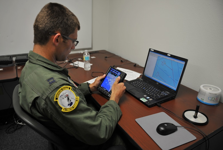 Capt. Caleb Whitlock, 2nd Fighter Training Squadron pilot, programs a GPS system June 1, 2016, at the 2nd FTS building. Because the T-38 Talon has no moving map displays, the GPS system provides increased situational awareness while flying. (U.S. Air Force photo by Senior Airman Dustin Mullen/Released)