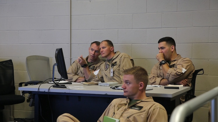 Pilots with Marine Medium Tiltrotor Squadron (VMM) 364 receive a briefing during Virtual Flag aboard Marine Corps Air Station Camp Pendleton, Calif., May 18. Virtual Flag is the flagship event for the U.S. Air Force Distributed Missions Operations Center of Excellence (DMOC) and is a quarterly exercise among military branches using various aircraft and mechanized simulators across the country. (U.S. Marine Corps photo by Sgt. Brian Marion/Released)