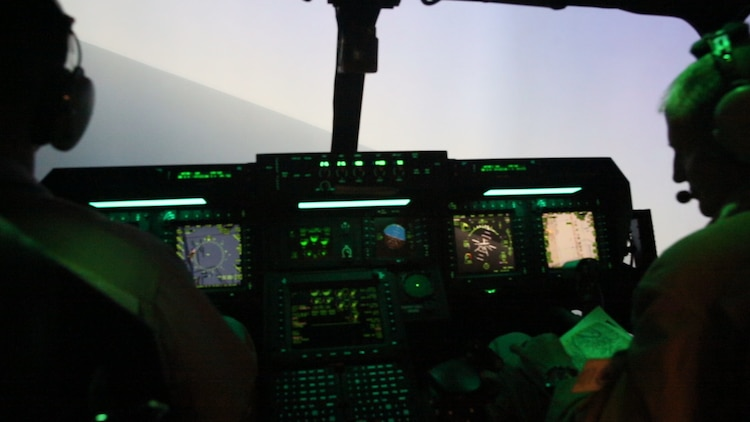 Pilots with Marine Medium Tiltrotor Squadron (VMM) 364 operate an MV-22 Osprey flight simulator during Virtual Flag aboard Marine Corps Air Station Camp Pendleton, Calif., May 18. Virtual Flag is the flagship event for the U.S. Air Force Distributed Missions Operations Center of Excellence (DMOC) and is a quarterly exercise among military branches using various aircraft and mechanized simulators across the country. (U.S. Marine Corps photo by Sgt. Brian Marion/Released)