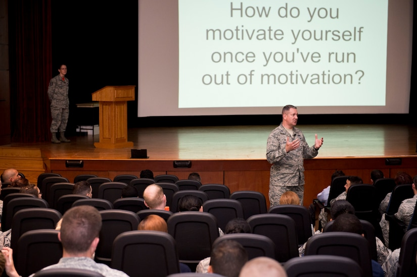 Col. Robert Lyman, Joint Base Charleston commander, responds to Airmen's questions during a commander's call June 3, 2016, at the base theater on JB Charleston – Air Base, S.C. JB Charleston members used their smartphones to ask anonymous questions. Lyman answered the questions at the end of the commander's call. For the questions he was unable to get to, Lyman responds after the commander's call by posting the answers to the base website. (U.S. Air Force photo/Senior Airman Clayton Cupit)