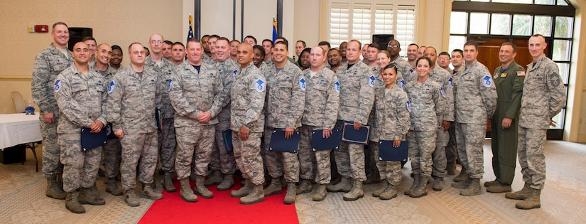 Joint Base Charleston's newest Master Sergeants pose for a group photo with their leadership during the Master Sergeant release party June 3, 2016, at the Charleston Club on JB Charleston – Air Base, S.C. Officials selected 5,019 of 21,504 eligible for promotion for a 23.34 percent selection rate. The average time in grade of the selectees' was 4.04 years and time in service was 14.59 years. The average decorations score was 11.47, United States Air Force Supervisory Examination average score was 63.08 and the average board score was 378.50. (U.S. Air Force photo/Senior Airman Clayton Cupit)
