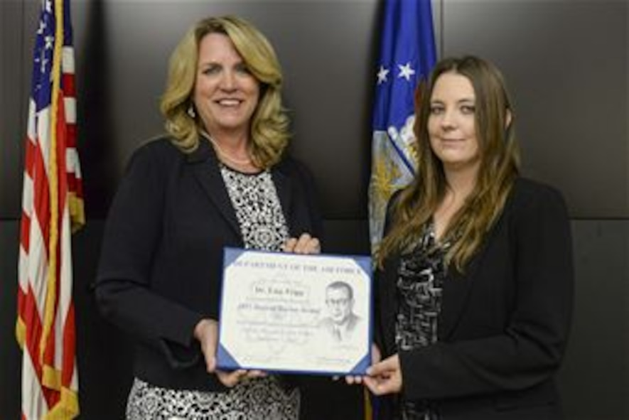 Secretary of the Air Force Deborah James (left) presents the 2015 Harold Brown Award  to Dr. Lisa Tripp during a ceremony June 6 at Wright-Patterson AFB.  The award is for her efforts in creating innovative and cost-saving training methods and platforms for the Air Force intelligence community, and is the highest award given by the Air Force to a scientist or engineer.  (U.S. Air Force photo/Wesley Farnsworth)