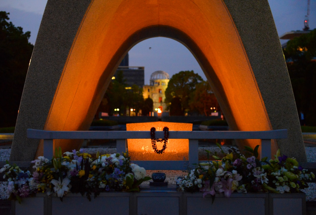 The Hiroshima Peace Memorial Monument frames the Atom-Bomb Dome at Hiroshima, Japan, May 31, 2016. The dome was preserved as a reminder of the destruction of atomic weapons in hopes that such weapons will never be used again.  (U.S. Air Force photo by Airman 1st Class Elizabeth Baker/Released)