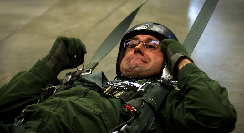 Staff Sgt. Erik Nosich, 144th Airlift Squadron loadmaster stationed at Joint Base Elmendorf-Richardson Alaska, practices being dragged by a parachute May 26, 2016, at Fairchild Air Force Base, Wash. The parachuting program's goal is to train all aircrew members, who could potentially have to bail out of their aircraft, on how to survive a parachute ride so they can be recovered by recovery personnel.  (U.S. Air Force photo/Airman 1st Class Sean Campbell)