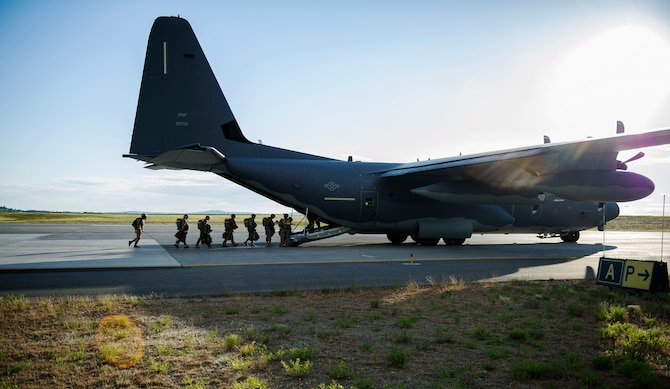 Survival, Evasion, Resistance and Escape specialists board a C-130 Globemaster before conducting a training jump May 25, 2016, at Fairchild Air Force Base, Wash. The Fairchild parachuting shop has started to map gear specific to the planes students will be flying on so when students go through training, they will be using the same parachute they receive in the field. (U.S. Air Force photo/Airman 1st Class Sean Campbell)