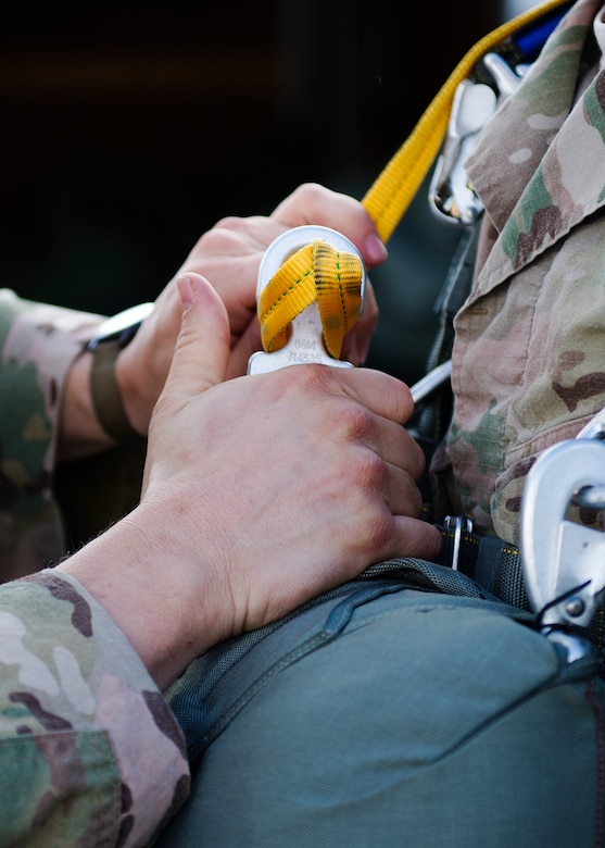 Before an Airmen jumps, they must go through a Jumpmaster Parachute Inspection where a certified jump master inspects the parachutist to ensure all the rigging is correct and that there are no deficiencies. Jumpmasters help with the pre-jump as well. The pre-jump happens before the jump and is when jumpers are briefed on how the jump will go, the safety and emergency procedures. (U.S. Air Force photo/Airman 1st Class Sean Campbell)