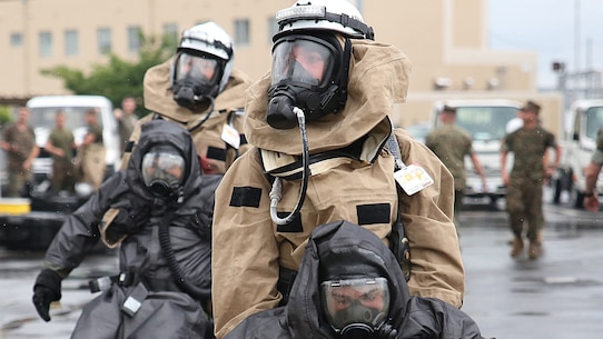 U.S. Marines from 3rd Marine Division, Chemical, Biological, Radiological and Nuclear defense platoon, Headquarters Battalion, III Marine Expeditionary Force, evacuate simulated casualties during exercise Habu Sentinel 16 at Disaster Village, Marine Corps Air Station Iwakuni, Japan, June 7, 2016. As the annual capstone exercise for the division's response element, this event encompasses multiple objectives specific to CBRN response and validates unit standard operating procedures in an unfamiliar training environment.