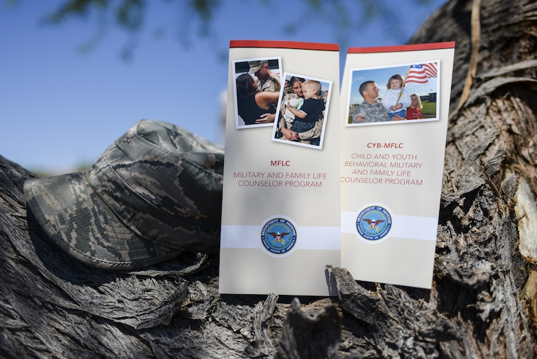 Brochures for the Military and Family Life Counselor Program rest on a tree at Nellis Air Force Base, Nev., June 1, 2016. The MFLC program offers short-term, non-medical counseling at no cost to active-duty service members, National Guard and reserve service members (regardless of activation status) and their families, as well as Department of Defense civilian expeditionary workforce members and their families. (U.S. Air Force photo illustration by Airman 1st Class Nathan Byrnes)