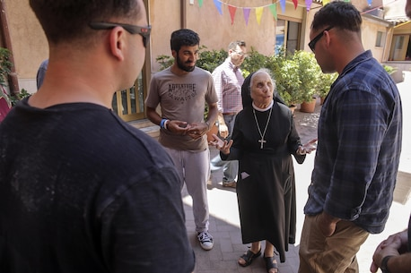 Marines with Special Purpose Marine Air-Ground Task Force Crisis Response-Africa, are given a farewell from the head sister at Marie Ausiliatrice School in Catania, Italy, June 7, 2016.  Marines volunteered their time performing general site maintenance and building an above ground pool in preparation for a summer camp at the orphanage.  (U.S. Marine Corps photo by Cpl. Alexander Mitchell/released)