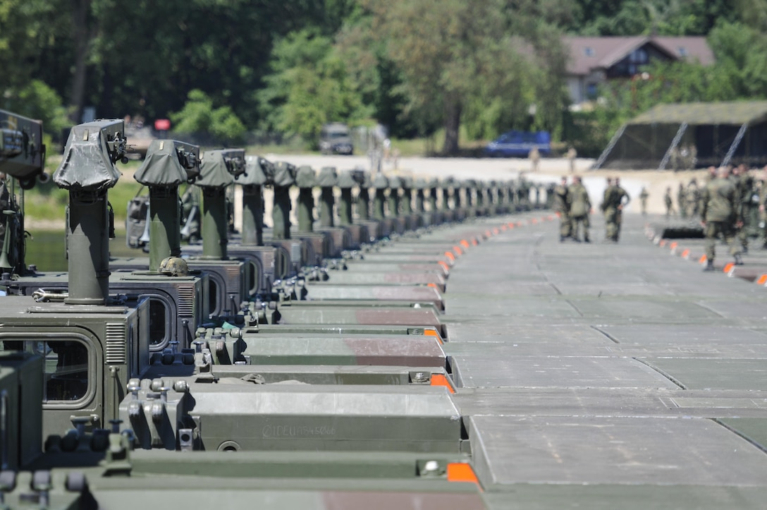 This bridge stretching the length of the Vistula River near Chelmno, Poland was created by connecting 34 U.K. and German Amphibioius Rigs together, which was then able to support 200 U.S. Army vehicles crossing, including Strykers. The multinational exercise set a new world record for building the longest Amphibious Rig vehicle bridge.  Anakonda 2016 is a Polish-led, joint multinational exercise taking place throughout Poland June 7-17. The exercise involves more than 25,000 participants from more than 20 nations. Anakonda 2016 is a premier training event for U.S. Army Europe and participating nations and demonstrates the United States and partner nations can effectively unite under a unified command while training on contemporary scenario. (U.S. Army photo by Staff Sgt. Debra Richardson (Released)