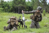 The gunner of a mortar team with 1st Battalion, 2nd Marine Regiment, 2nd Marine Division, prepares to drop a round into the mortar barrel at Marine Corps Base Camp Lejeune, North Carolina, June 6, 2016. Marines underwent mortar familiarization and proficiency training in preparation for their upcoming deployment in support of Special-Purpose Marine Air-Ground Task Force.