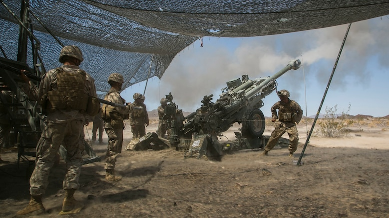 Marines with Battery C, 1st Battalion, 10th Marine Regiment, provide indirect fire with a M777 Howitzer during the final exercise of Integrated Training Exercise 3-16 in the Blacktop Training Area aboard Marine Corps Air Ground Combat Center, Twentynine Palms, California, June 1, 2016.