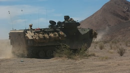 Marines with 3rd Battalion, 2nd Marine Regiment, advance to a simulated enemy defensive position in an Assault Amphibious Vehicle during the final exercise of Integrated Training Exercise 3-16 in the Blacktop Training Area at Marine Corps Air Ground Combat Center, Twentynine Palms, California, June 1, 2016.
