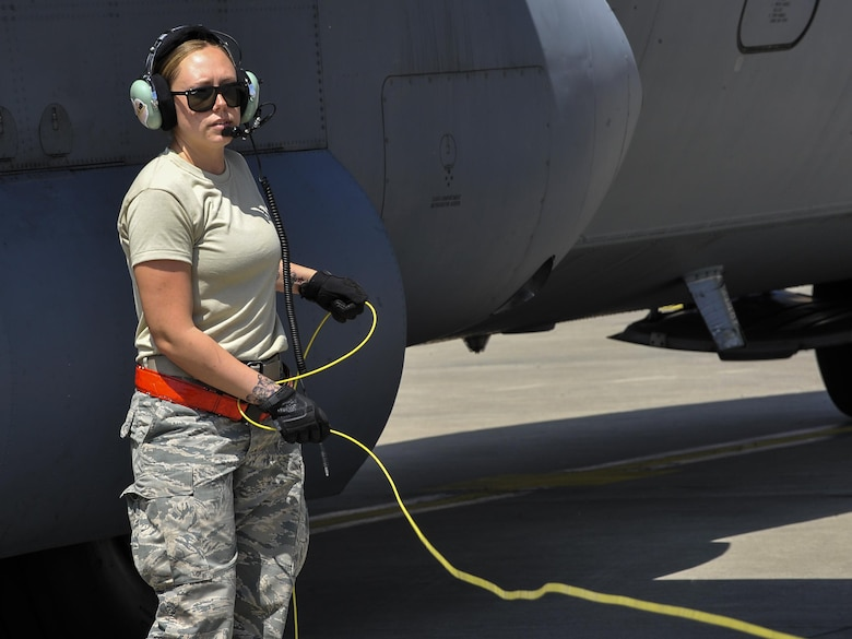 Staff Sgt. Chelsie Busbin, 317th Aircraft Maintenance Squadron flying crew chief, disconnects an aircraft and fuel truck after a refuel June 9, 2016, at Ramstein Air Base, Germany. More than 5,000 military members from 10 NATO countries are participating in this year's annual Exercise Swift Response 2016  from May 27 through June 26. Swift Response is a joint, multinational-exercise designed to train the U.S. Global Response Force alongside high-readiness forces from Belgium, France, Germany, Italy, The Netherlands, Poland, Portugal, Spain and the United Kingdom. (U.S. Air Force photo/Senior Airman Larissa Greatwood)