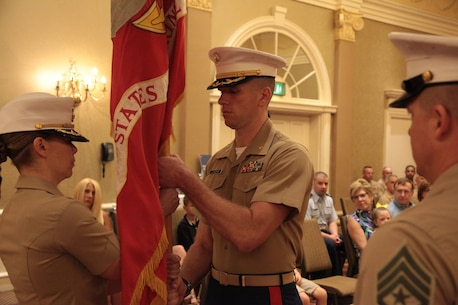 "Maj Kathryn Wagner relinquishes command to Maj Jonathan Landers as the Commanding Officer for Recruiting Station Nashville, TN during the change of command ceremony at the Music City Sheraton Hotel June 8, 2016. ""You are getting a truly professional and dedicated group of Marines that are ready to go in any direction you point to without fail,"" said Maj Wagner to Maj Landers. ""I am truly honored and humbled to be your new CO,"" said Maj Landers to the Marines. ""Nashville is where I wanted to be. There is nowhere else I wanted to be as CO then right here."" (Official Marine Corps photo by Sgt. Michael Iams)"