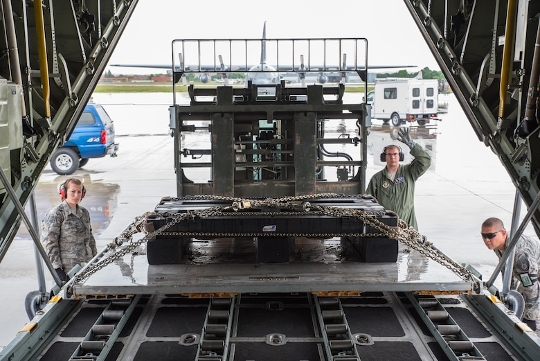 Staff Sgt. James Goetze, a loadmaster from the 96th Airlift Squadron, guides a load onto the aircraft with the assistance of Tech. Sgt. Jerome Wy and Senior Airman Breanna Moravec of the 27th Aerial Port Squadron . (U.S. Air Force photo by Master Sgt. Eric Amidon)