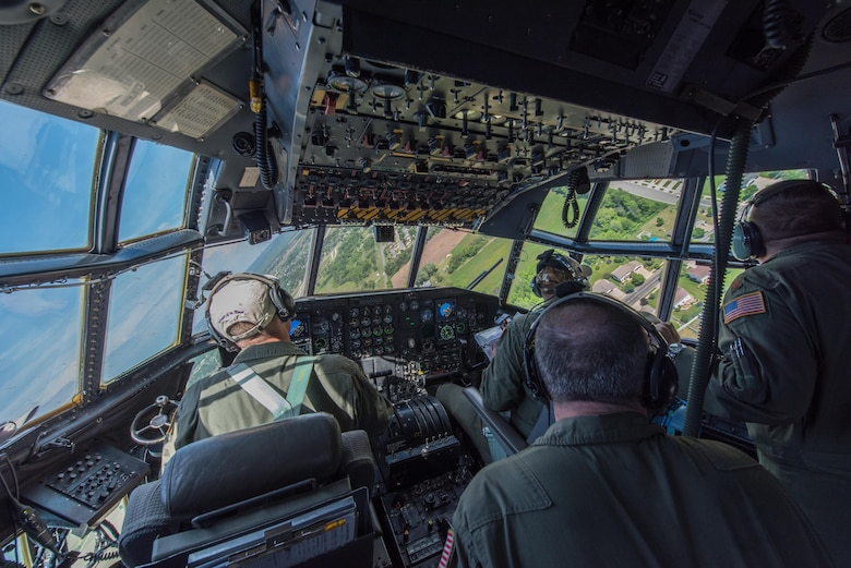 Maj. Ethan Bryant maneuvers through the course as Capt. Mike McFadden, Maj. John Johnston and Master Sgt. Quentin Will scan the area for the next objective.  (U.S. Air Force photo by Master Sgt. Eric Amidon)