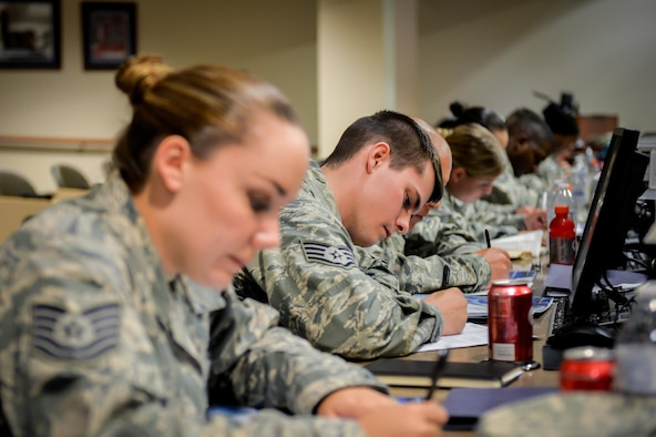 Participants fill out questionnaires during the 2016 Striker Stripe Conference held at Barksdale Air Force Base, La., June 8, 2016. (U.S. Air Force photo/Senior Airman Mozer O. Da Cunha)