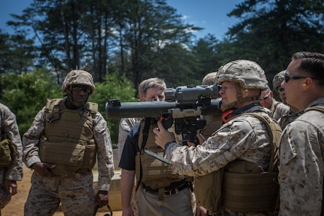 The 37th Commandant of the Marine Corps, Gen. Robert B. Neller, with the 18th Sergeant Major of the Marine Corps (left), participate in a demonstration of the Shoulder-Launched Multipurpose Assault Weapon (SMAW) and the Multi-Role Anti-Armor Anti-Personnel Weapon System (MAAWS) at Marine Corps Base Quantico, VA., June 8, 2016. (U.S. Marine Corps photo by Sgt. Melissa Marnell/Released)