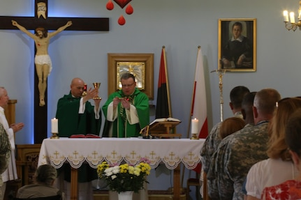 SZCZECIN, Poland—U.S. Army National Guard Maj. Patrick Paul Brownell, the Chaplain for the 230th Sustainment Brigade, Chattanooga, Tenn., preaches to a Polish congregation during NATO training exercise Anaconda 16 on June 6. Brownell was invited by Polish Army Chaplain, Capt. Thomasz Szeflinski to co-officiate the services using a local interpreter. Exercise Anakonda 16 is a Polish-led, joint, multinational exercise taking place in Poland involving more than 25,000 participants from 24 nations. (Photo by Capt. A. Sean Taylor, 649th RSG)