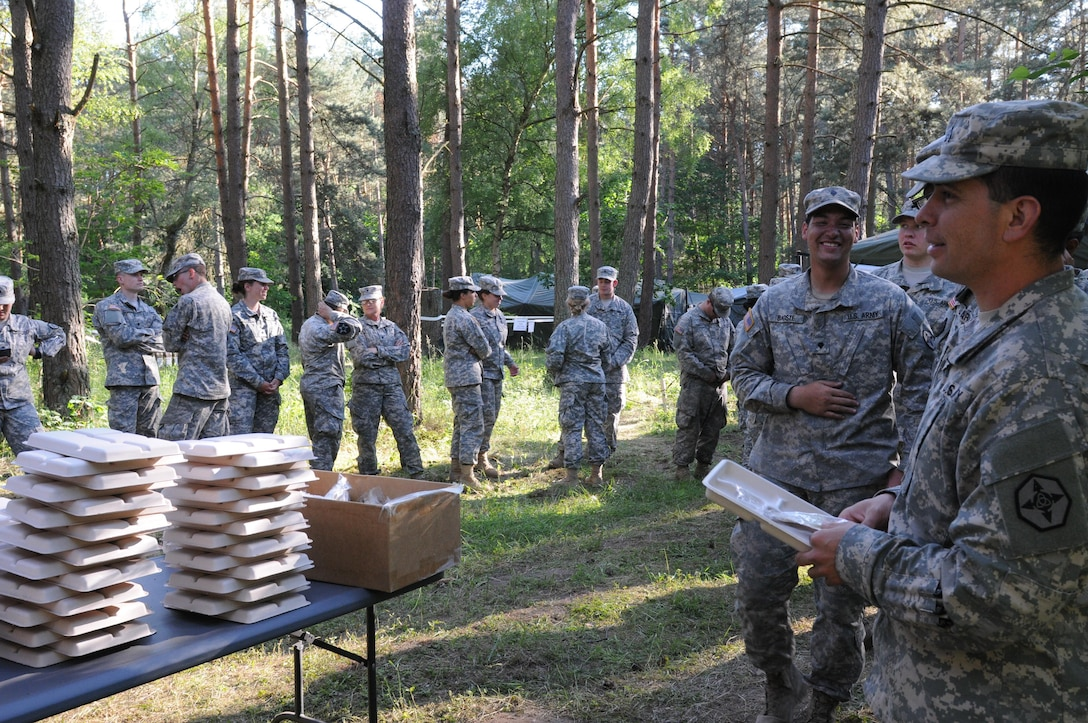 Soldiers participating in Anakonda 16 wait for food that is being served from a Mobile Kitchen Trailer (MKT) at the Drawsko Pomorskie Training Area in Poland. Anakonda 16 is a premier training event for U.S. Army Europe and participating nations and demonstrates that the United States and partner nations can effectively unite together under a unified command while training on a contemporary scenario. The MKT is being operated by soldiers from 483rd Quartermaster Company based in Marysville, Wash., and the 716th Quartermaster Company based in Jersey City, NJ. (Photo by Sgt. 1st Class Kenny Scott)