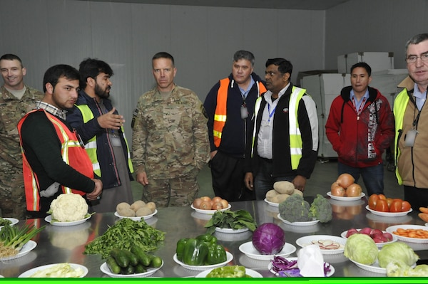 Brig. Gen. Andrew Rohling (center), U.S. Forces Afghanistan Deputy Deputy Commanding General-Support, receives a briefing from Anham personnel during a recent facility tour. Anham provides all the food that warfighters consume in Afghanistan.