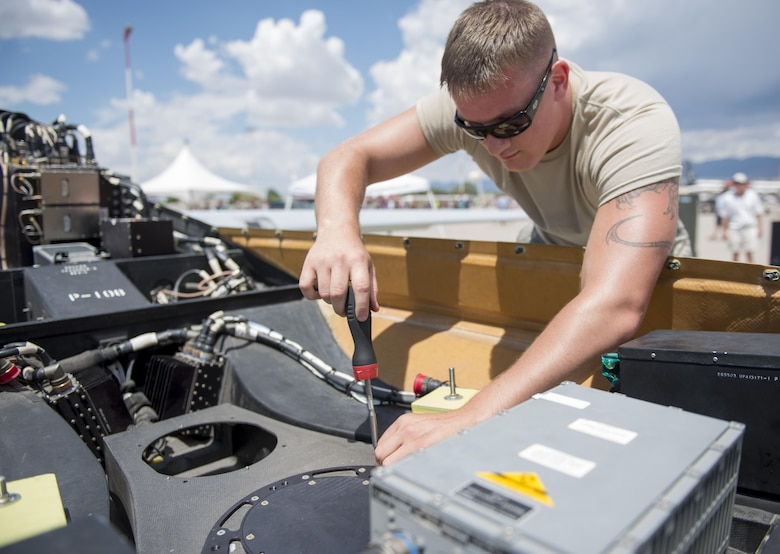Senior Airman Thomas, a 9th Aircraft Maintenance Unit avionics specialist at Holloman Air Force Base, N.M., assembles an MQ-1 Predator at Kirtland AFB on June 4. Over 50,000 people visited the Kirtland AFB Open House on June 4 and 5. Holloman Airmen had the opportunity to display an MQ-1 Predator and answer questions visitors had about RPAs and their mission at Holloman. (Last names are being withheld due to operational requirements. U.S. Air Force photo by Airman 1st Class Randahl J. Jenson)