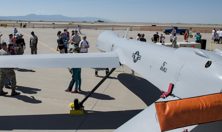 Visitors view an MQ-1 Predator at Kirtland Air Force Base, N.M. on June 5. Visitors to the open house were able to walk around the Remotely Piloted Aircraft and ask questions to Holloman Airmen regarding the aircraft and their mission at Holloman. (U.S. Air Force photo by Airman 1st Class Randahl J. Jenson)