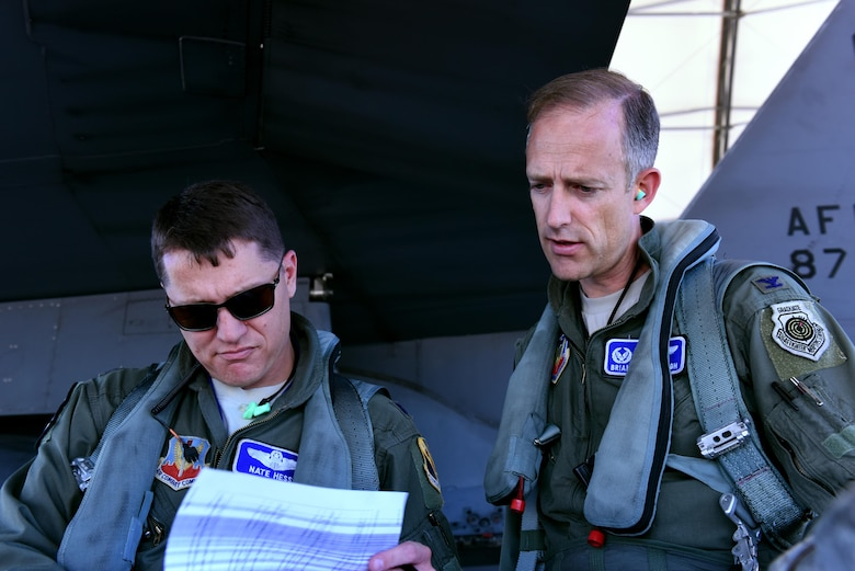 Lt. Col. Nate Hesse (left), 4th Operations Group deputy commander, and Col. Brian Afflerbaugh, 4th OG commander, review pre-flight information June 8, 2016, at Seymour Johnson Air Force Base, North Carolina. Afflerbaugh was completing his final mission as group commander. (U.S. Air Force photo/Tech. Sgt. Chuck Broadway)
