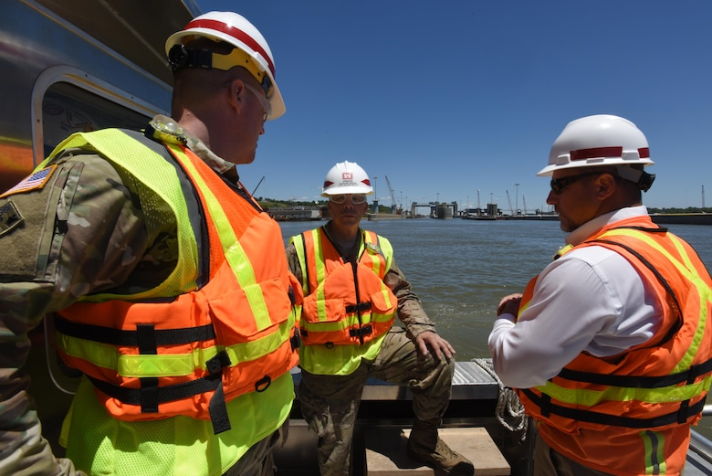 Lt. Gen. Todd T. Semonite (Center), U.S. Army Corps of Engineers commander and chief engineer, tours the Olmsted Lock and Dam project on a vessel in the Ohio River June 7, 2016.  Col. Christopher Beck (Left), Louisville District commander, and Mick Awbrey, deputy chief of the Olmsted project, brief the general on the ongoing construction work.