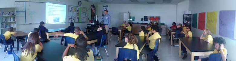 Water Safety Project Manager Dave Swiatek talks to a group of fifth grade students at the Charter School for Applied Technologies to remind them when in the water, wear your life jacket, May 25, 2016.