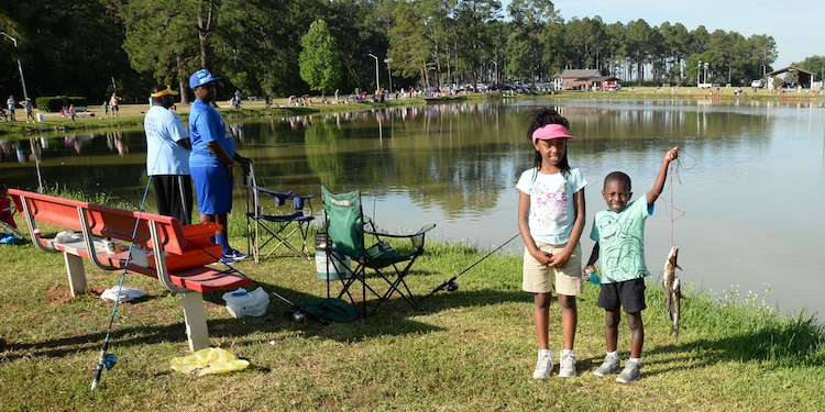 Young anglers, four-year old Prez Parks (right) and eight-year old Emmaya Parks are among the fisherman participating in the 28th Annual Buddy Fishing Tournament at Marine Corps Logistics Base Albany, June 4. Several trophies were awarded for the biggest fish in various age groups, at the weigh in at the end of the tournament. The event, held at Covella Pond, here, is opened to community youth 15 years and younger.