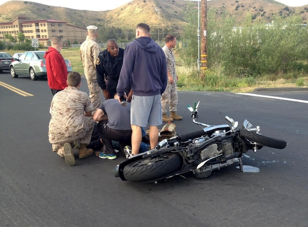 U.S. Marine Sgt. Brandon Jackson is treated for injuries sustained in a motorcycle accident by corpsmen aboard Camp Pendleton, Calif., May 23, 2016. Jackson, an airframes mechanic instructor at the Center for Naval Aviation Technical Training,was on his daily commute to work when he collided with a passenger vehicle. He sustained only minor injuries in the accident. (Courtesy Photo)