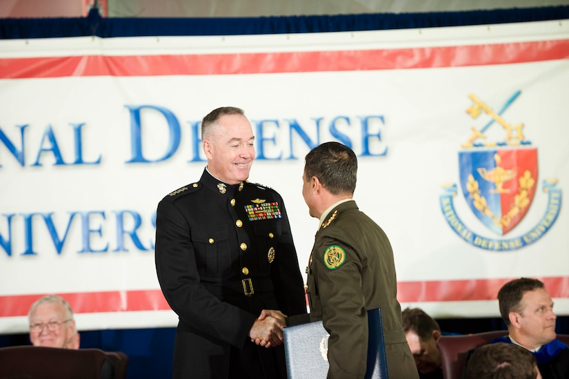 Marine Corps Gen. Joe Dunford, chairman of the Joint Chiefs of Staff, congratulates graduates during the National Defense University's 2016 graduation ceremony at Fort Lesley J. McNair in Washington, D.C., June 9, 2016. DoD photo by Army Staff Sgt. Sean K. Harp