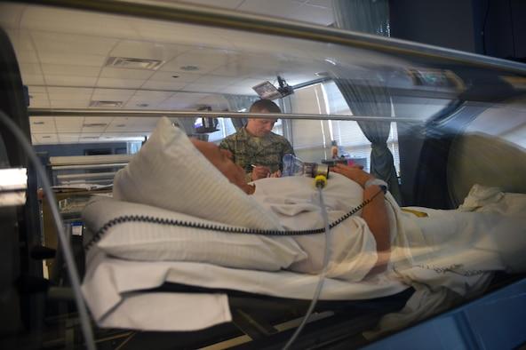 Col. Michael Richards, 59th Medical Specialties Squadron Hyperbaric Medicine Flight commander, assess responses