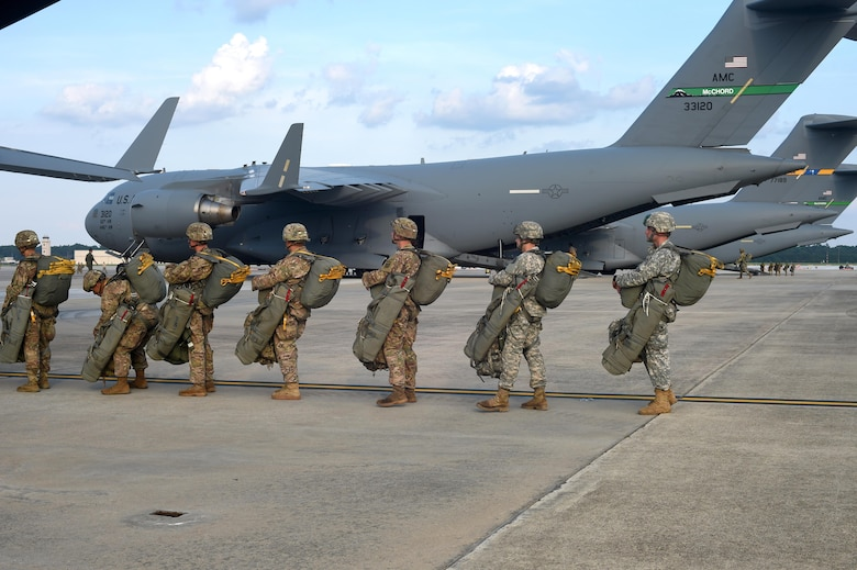 82nd Airborne Division Soldiers load into a 62nd Airlift Wing C-17 Globemaster III prior to a static line jump at Pope Army Air Field, North Carolina, June 4, 2016. Three McChord C-17's met up with four Joint Base Charleston, South Carolina, C-17's to conduct the personnel air drop for training prior to departing for Europe to participate in a multi-national exercise, known as Swift Response (U.S. Air Force photo/Staff Sgt. Naomi Shipley)